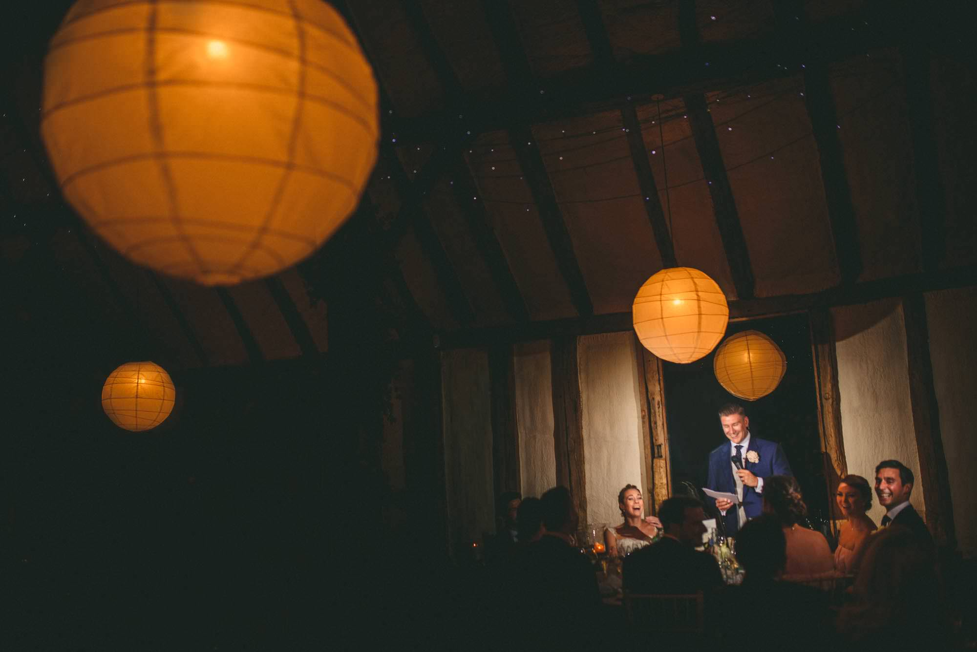 The groom delivers speech at Elegant winters barn wedding Kent
