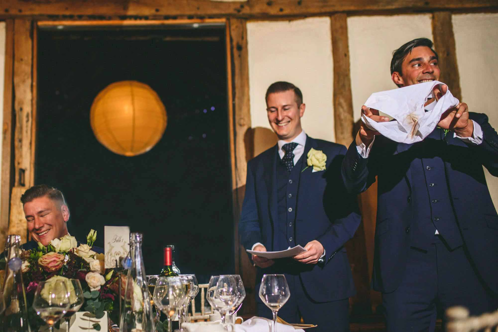 Groomsmen hold up dirty pants during wedding speeches Kent