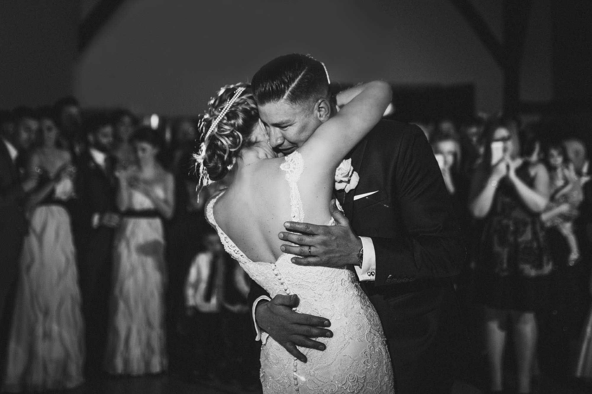 Enzoani custom Fifi, JS Couture bride hugs groom on Kent dance floor