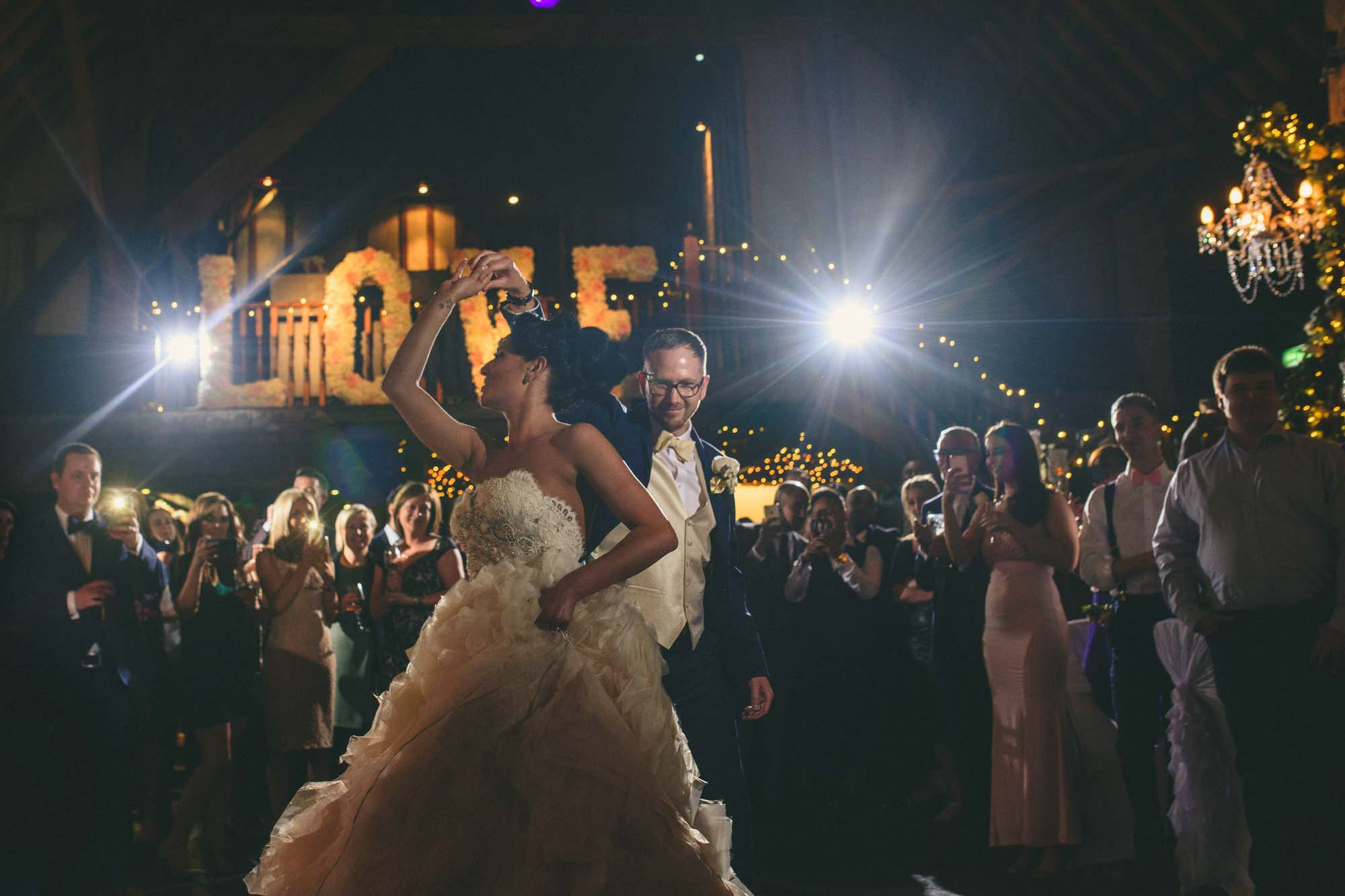 Bride with groom during first wedding dance Castle Barn Rochester