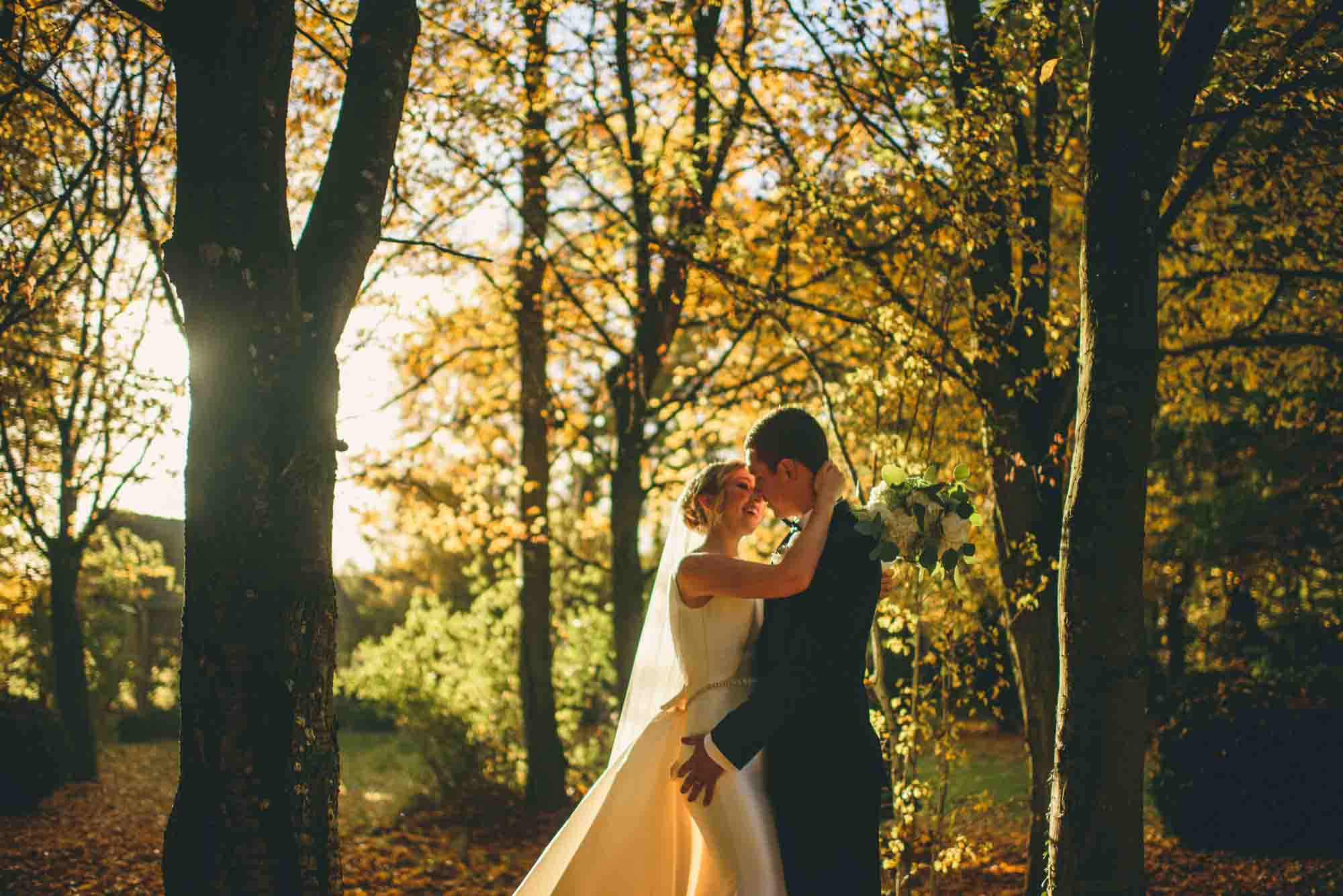 Bride and Groom in Autumn Woods Photo at Cripps Barn Wedding